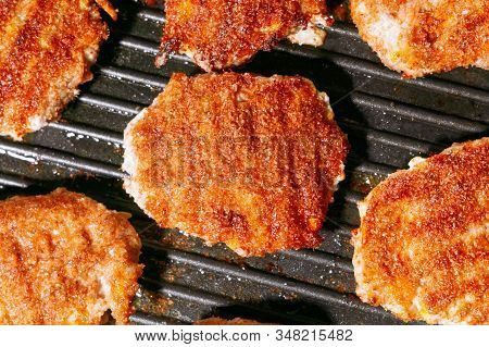 Close Up Of Juicy Beef Burger Patties Grilling On A Griddle Pan