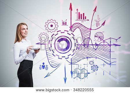 Smiling Blonde Businesswoman With Coffee Standing Near Gray Wall With Creative Business Plan Sketch