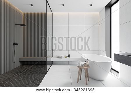 Interior Of Spacious Bathroom With White Tile And Gray Walls, Tiled And Wooden Floor, Comfortable Ba