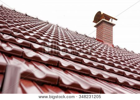 New Red Chimney On New Roof With Burgundy Covering