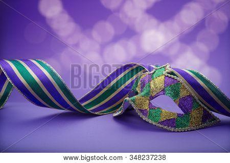 Traditional Carnival Mardi Gras Mask On Table .masquerade Mask On Glitter Background. Mardi Gras