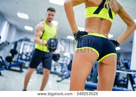 Fitness Woman With Fit Cheeks, Tight Hips And Firm Buttocks In Workout Shorts . Perfect Female Ass I