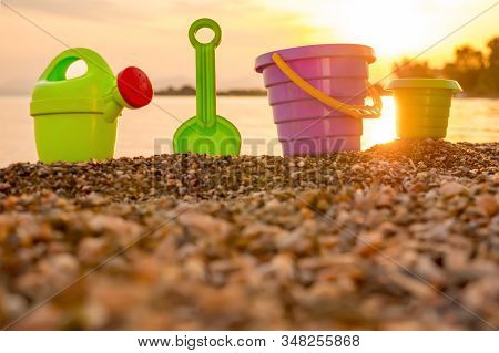 Beach Kids Toys On Pebble. Tourism Background. Travel With Children. Summer Vacation Concept. Toys O