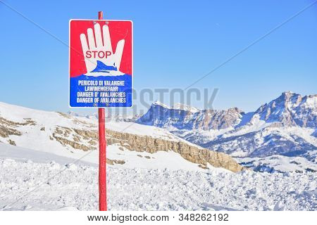 Avalanche Warning Sign Saying Danger Of Avalanches In Italian, German, French, And English Languages