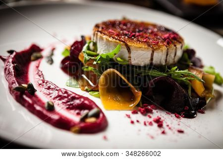 Grilled goat cheese salad: Pickled beetroot and pumkin, cranberry jam, pumkin seeds