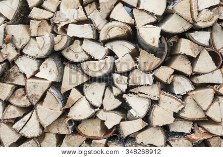 The Woodpile Of Harvested Stacked Chopped Firewood