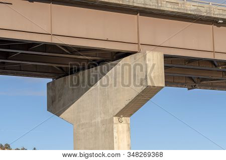 Close Up Of The Abutment Supporting The Span Of A Beam Bridge On A Sunny Day