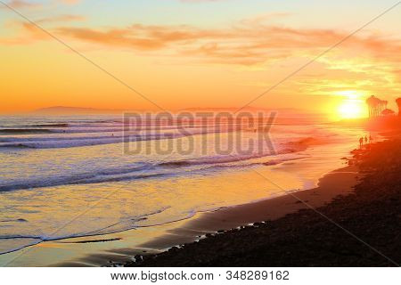 Sunset On A Vast Beach With Large Waves Crashing Onshore Taken In Ventura, Ca