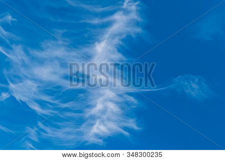 Blue Sky Wallpaper With Light White Clouds.