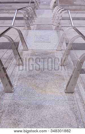 Modern Metal Railing On Granite Staircase. Perspective View Of Iron Shiny Polished Railings. Contemp