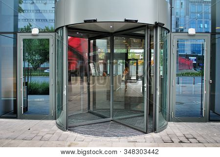 Revolving Glass Doors On Glass Walled Building