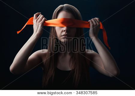 The Girl Blindfolded Herself, With Red Tape, A Game On A Black Background