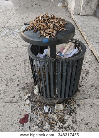 Disgusting Trash, Cigarette Litter In Urban Location