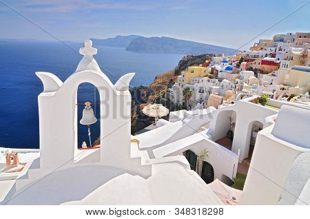 Santorini Landscape With White Greek Bell Tower And Sea In The Background Oia Town, Santorini Island