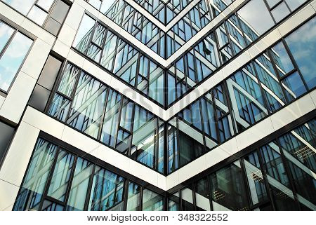 Abstract Image Of Looking Up At Modern Glass And Concrete Building. Architectural Exterior Detail Of