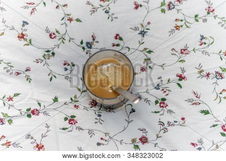 Top View Of A Black Coffee With A Flowery Background