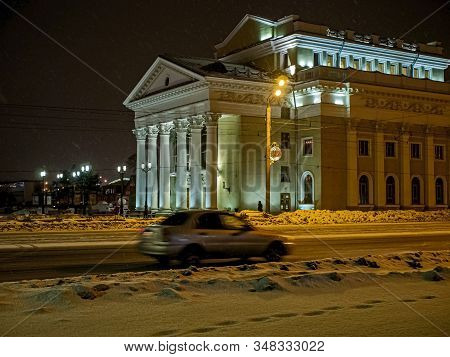 Night View Of The Organ Hall Building During A Snowfall In Chelyabinsk. The Snow In The Photo Looks