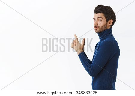Sassy Handsome Man In Stylish High Neck Sweater, Standing In Profile Turn At Camera With Assertive,