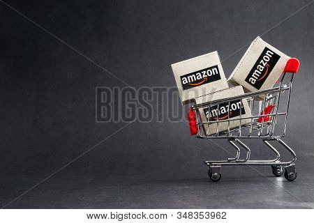 Kuala Lumpur, Malaysia - January 29, 2020 : Amazon Shipping Packages Boxes And Shopping Cart On Blac