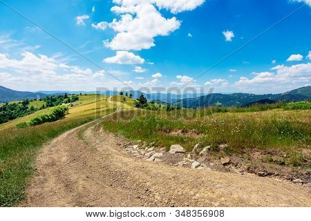 Mountain Rural Landscape In Summertime. Country Path Winding Off In To The Distant Ridge. Rolling Hi