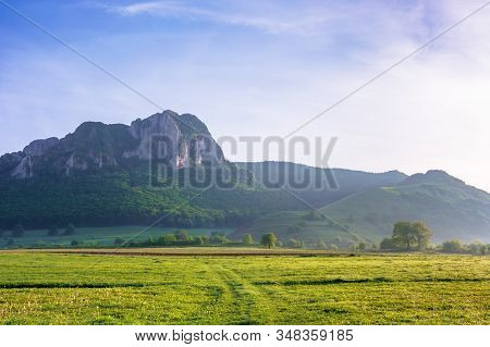 Rock Formation On The Field At Sunrise. Beautiful Rural Landscape In Mountains. Wonderful Scenery In