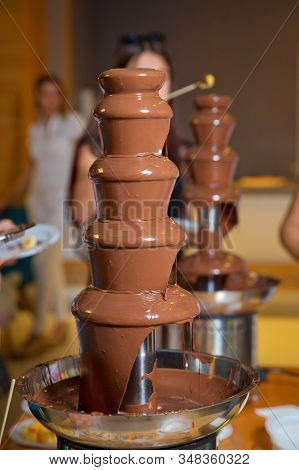 Chocolate Fountain With Fruits. Children Birthday Party . Homemade Chocolate Fountain Fondue With Ma