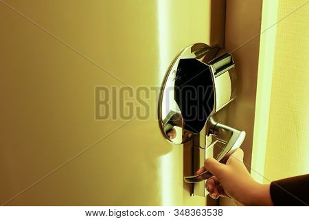 Women Hand Reaching To Open Electronic Key Card Door Knob To Enter Hotel Room. Luxury Resident With