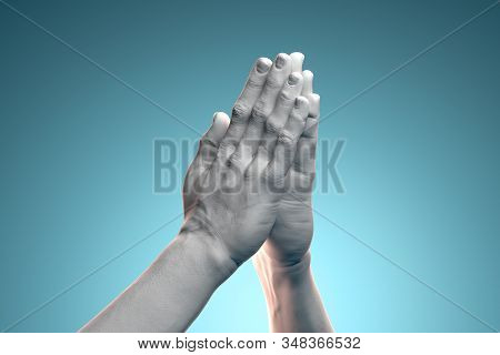 Realistic White Human Hands Folded In Prayer On Blue Background. 3d Rendering. Concept Of Connection