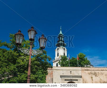 Nitra Castle Located In Old Town Of Nitra, Slovakia. Main Entrance Of Castle Decorated With Old Meta