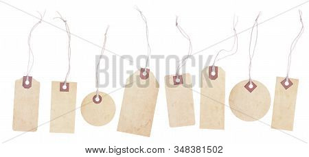 A Collection Of Eight Old Yellowing Paper Tags. Each Tag Has A String Tie And Is Blank With Room For