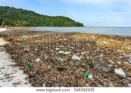 Environmental Disaster. Garbage Dump On Bai Sao Beach With White Sand On The Coastline. Plastic Rubb