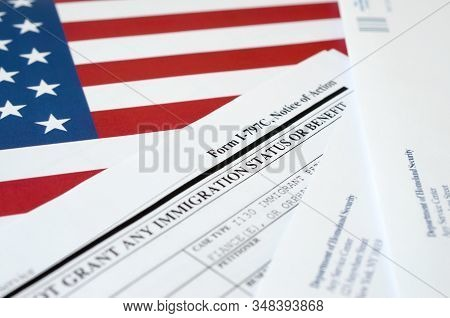 I-797c Notice Of Action Blank Form Lies On United States Flag With Envelope From Department Of Homel