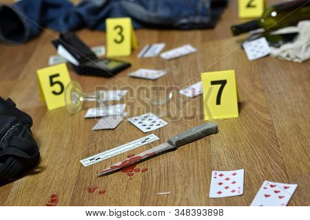 Crime Scene Investigation - Numbering Of Evidences After The Murder In The Apartment. A Lot Of Playi