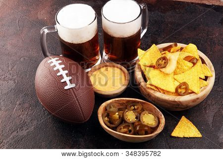 Homemade Nachos With Cheddar Cheese And Jalapenos And Beer For Football. Great For Bowl Game Party.