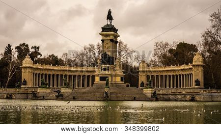 Close-up Of The Monument Of Alfonso Xii In The Retiro Park On A Cloudy Winter Day In Madrid. Horizon