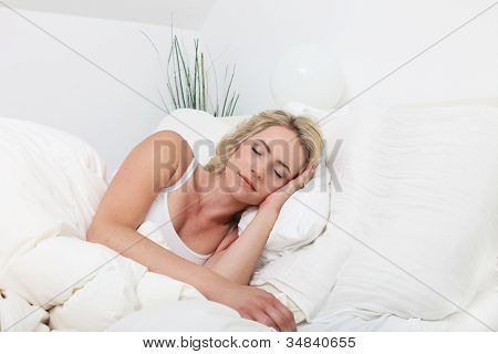 Young Lady Sleeping Peacefully In Bed