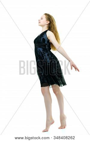 Portrait Of A Positive And Stylish Little Girl In A Summer Dress, Rejoices In The Wind That Blows An