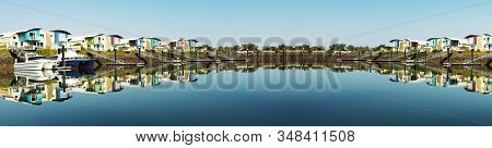 Super Panoramic Waterfront Maritime Marina/dock With Boats In Tropical Water With Blue Sky Backdrop.