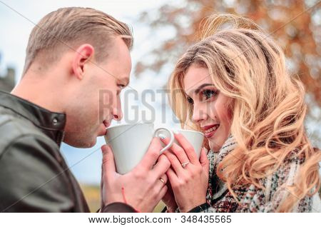 Happy Couple In Love Outdoors On An Autumn Day Look At Each Other With Love Eyes And Warm Themselves