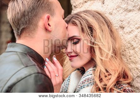 Guy Gently Kisses His Girlfriend On The Forehead On A Date, The Concept Of A Romantic Relationship B