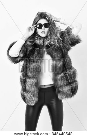 Woman Wear Sunglasses And Hairstyle Posing Mink Or Sable Fur Coat. Fur Fashion Concept. Winter Elite