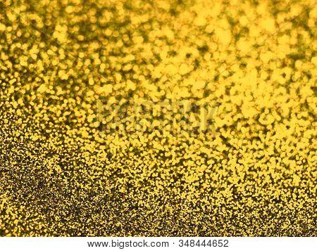 Golden Bokeh Lights Background. Beautiful Festive Backdrop. Design For Your Ad, Poster, Banner