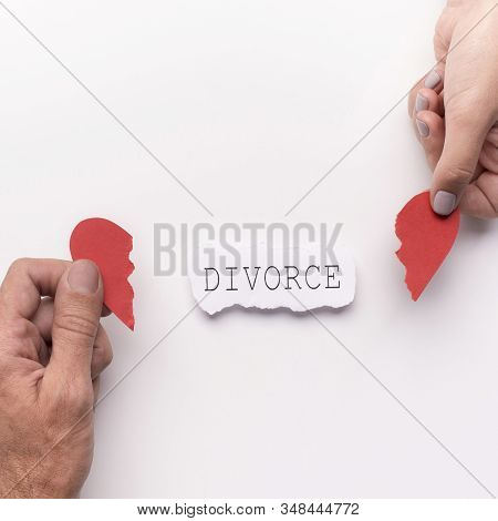 Complicated Relationship, Divorce Concept. Husband And Wife Planning Divorce And Holding Broken Hear