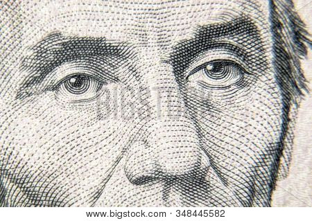 Abraham Abe Lincoln Face On 5 Dollar Bill Close Up. Detail Of New Currency Note. Macro View Of Linco
