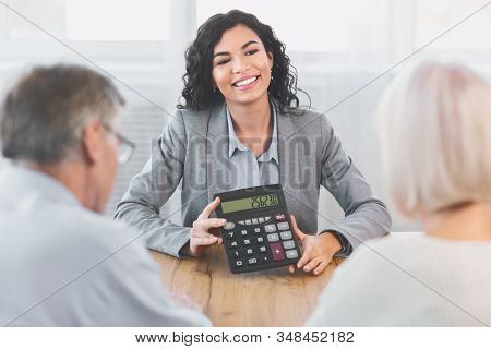 Financial Advice. Professional Insurance Agent Holding Calculator, Showing Amount Of Insurance Case