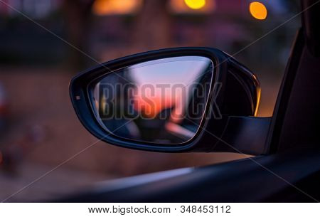 Car Rearview Mirror With Reflection Of Sunrise.
