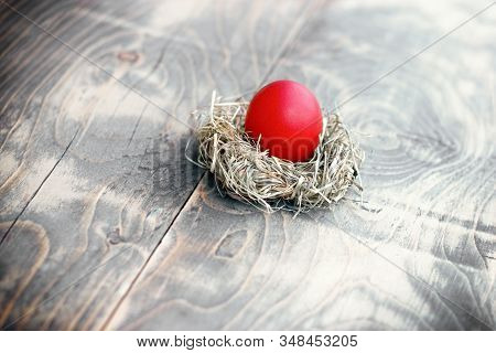 Easter Egg, Red Easter Egg In Nest On Rustic Table