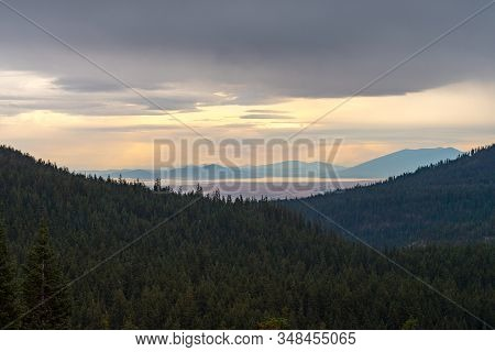 Forests, Lake And Storm Clouds Seen From Crater Lake, Oregon, Usa