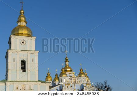 Orthodox Temple With Golden Baths On A Blue Background. The Concept Of Orthodoxy
