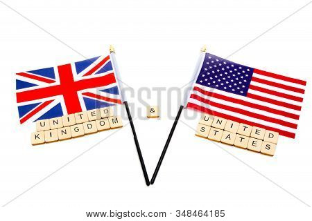 The Flags Of The United Kingdom And The United States Isolated On A White Background With A Sign Rea